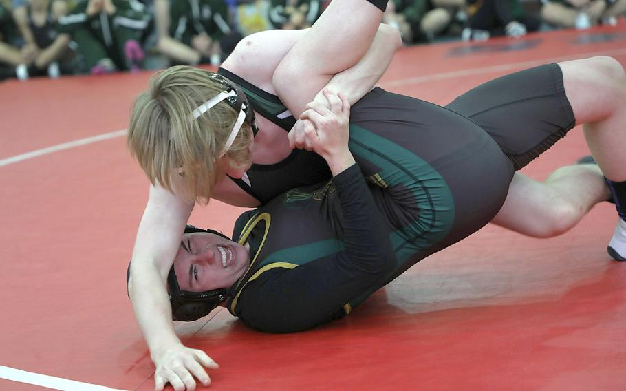 SHAPE's Sophia Marro, bottom, resists being pinned by AFNORTH's Connor Horton, at the Lakenheath's season opening competition held Saturday at RAF Lakenheath.