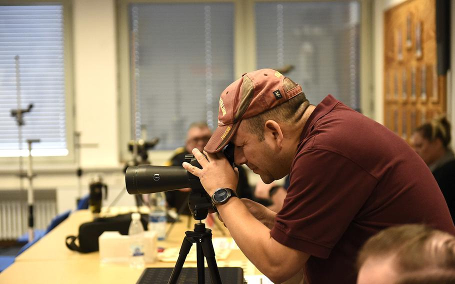 John Sabala, the marksmanship coach at Vilseck, sights in on a target during a marksmanship competition held at Vilseck, Saturday, Dec. 14, 2019. The competition included competitors from Stuttgart, Hohenfels, Ansbach and Vilseck high schools.