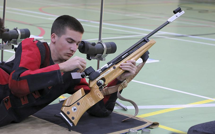 Baumholder's Jacob Gregg reloads his air rifle during a marksmanship competition held at RAF Alconbury, Saturday, Dec. 14, 2019. Competitors from Kaiserslautern, Wiesbaden, Baumholder, Spangdahlem, SHAPE, and Alconbury high schools took part in the event.