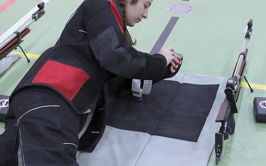 Kaiserslautern's Juliana Hosey prepares her air rifle during a marksmanship competition held at RAF Alconbury, Saturday, Dec. 14, 2019.