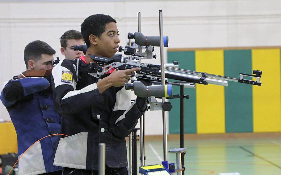 Wiesbaden's Jaden Anderon prepares to fire a shot at a target during a marksmanship competition held at RAF Alconbury, Saturday, Dec. 14, 2019.