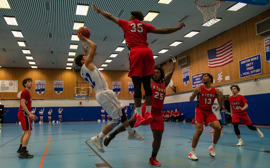 Kaiserslautern's Tre Dotson blocks a shot during a basketball game against Ramstein at Ramstein High School, Germany, Dec. 17, 2019. Ramstein won the game 72-56.