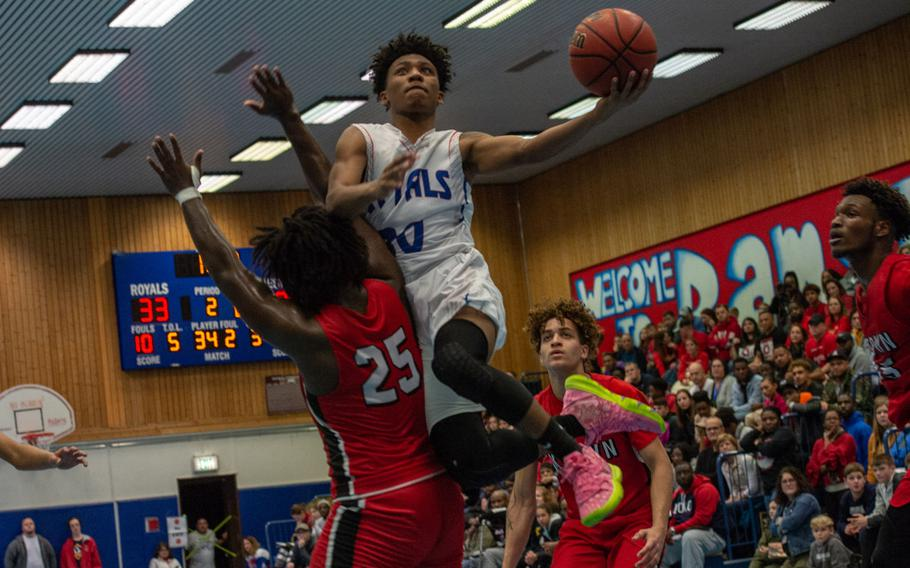 Ramstein's Jerod Little drives to the basket during a basketball game against Kaiserslautern at Ramstein High School, Germany, Dec. 17, 2019. Ramstein won the game 72-56.