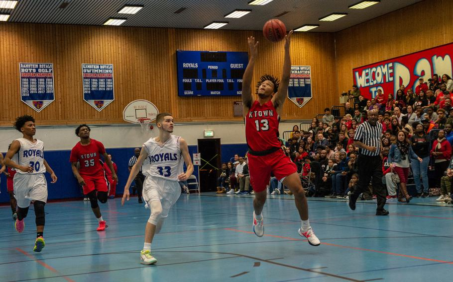 Kaiserslautern's Danus Camp catches the ball on a fast break during a basketball against Ramstein at Ramstein High School, Germany, Dec. 17, 2019. Ramstein won the game 72-56.