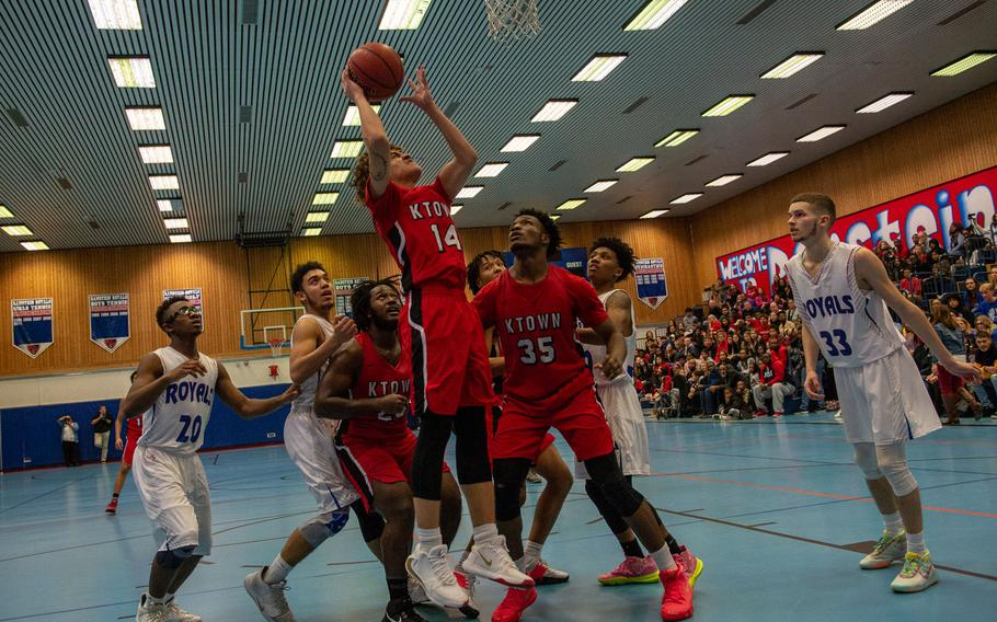 Kaiserslautern's Brandon Morris makes a lay-up during a basketball game against Ramstein at Ramstein High School, Germany, Dec. 17, 2019. Ramstein won the game 72-56.