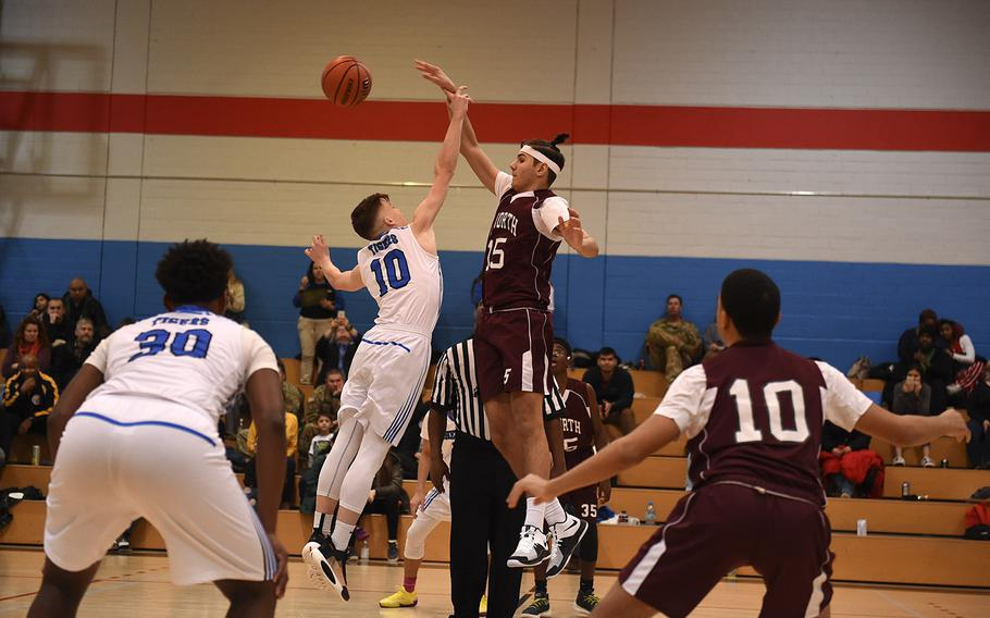 The Hohenfels Tigers and AFNORTH Lions' boys basketball teams tip-off at Friday's game, which was held at Hohenfels. The Hohenfels Tigers came out victorious in the game.
