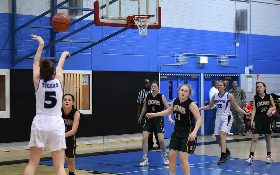 Karlie Perez from Hohenfels shoots the ball during Friday's game between AFNORTH's and Hohenfels' girls varsity basketball teams, which was held at Hohenfels. The AFNORTH Lions won the game.