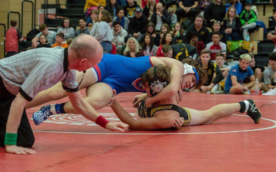 Ramstein's Sean Hogan rolls Stuttgart's Noah Carges during a wrestling tournament at Kaiserslautern High School, Germany, Saturday, Jan. 18, 2020.   Hogan won the watch with a pin.