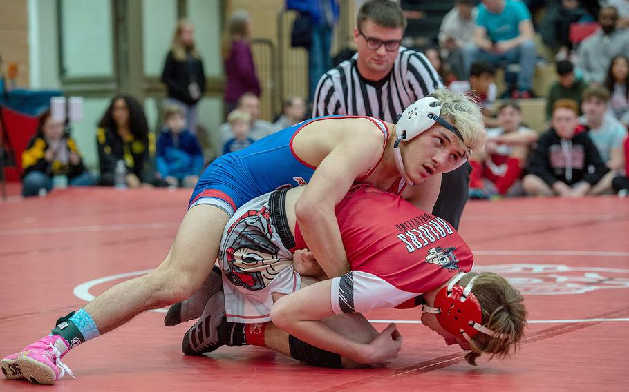 Ramstein's Conner Mackie takes down Kaiserslautern's Brandon Patterson during a wrestling tournament at Kaiserslautern High School, Germany, Saturday, Jan. 18, 2020. Mackie won the watch with a pin.