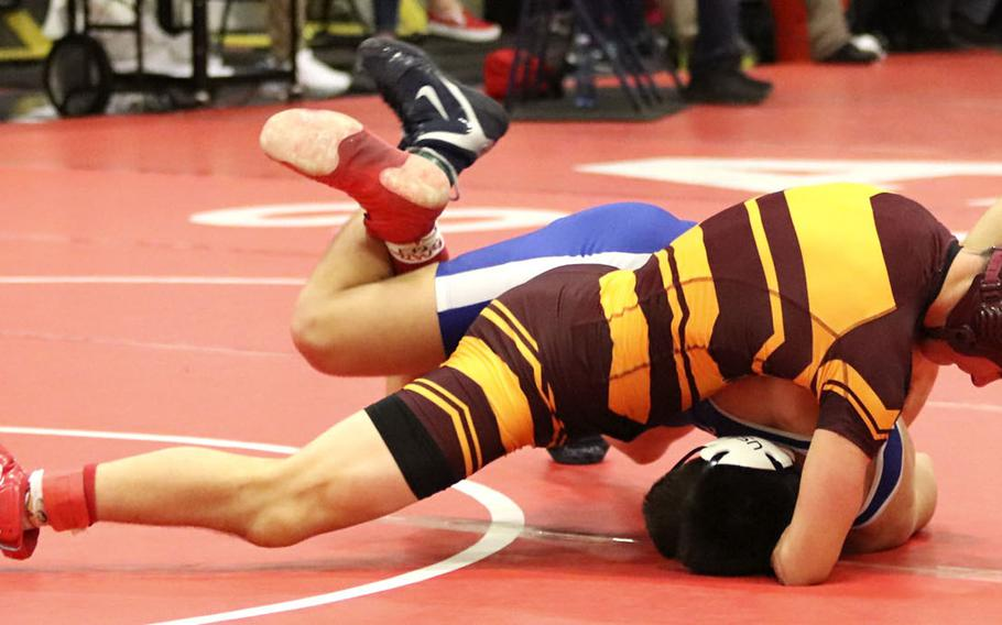 Hyrum Draper of the Vilseck Falcons attempts to pin Brenon Colvin of the Rota Admirals during Saturday's wrestling tournament held at Aviano. Despite Draper winning this match, Colvin finished the day in first place at the 182-pound weight class.