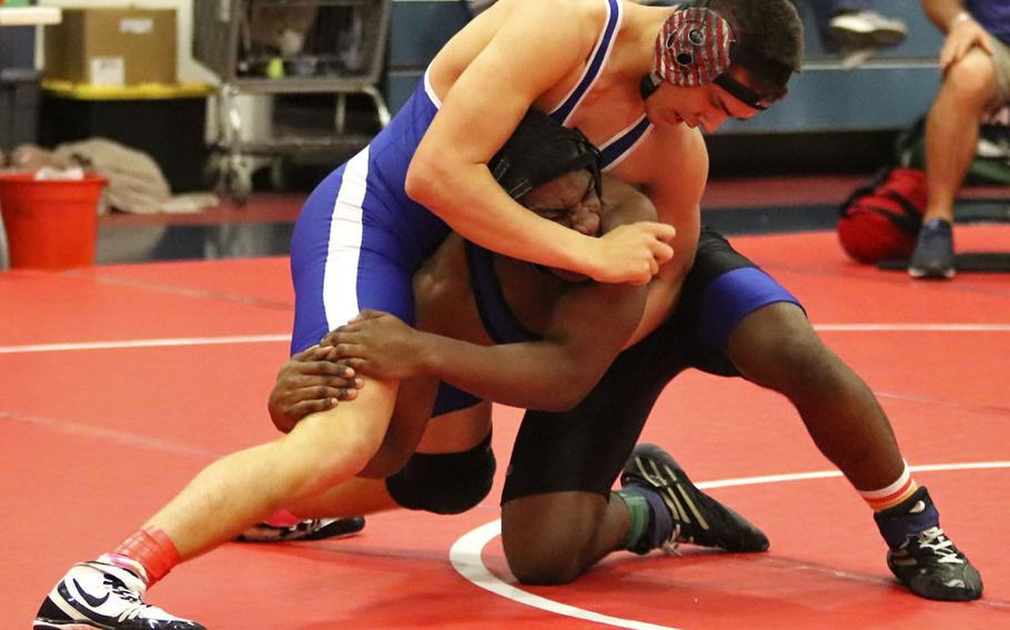 Easton Colvin of the Rota Admirals attemps to gain the upper hand against Brooklyn Davis of the Hohenfels Tigers in the 170-pound weight class' first place match during Saturday's wrestling tournament held at Aviano. Colvin won the match by pin.