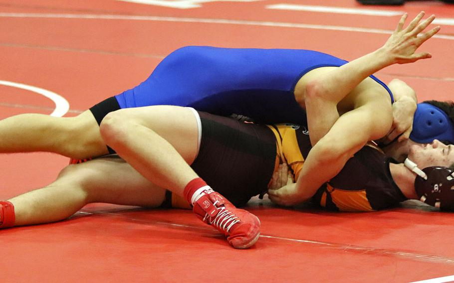 Jaiden Workman of the Hohenfels Tigers attemps to pin Tyler Butterfield in Saturday's wrestling tournament held at Aviano.