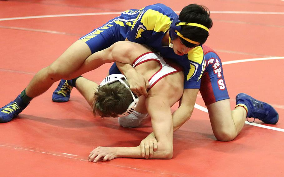 Noah Bachicha of the Sigonella Jaguars tries to pin Keegan Elliot of the Aviano Saints during Saturday's wrestling tournament held at Aviano. Bachicha was able to pin Elliot for the win in the 138-pound weight class.