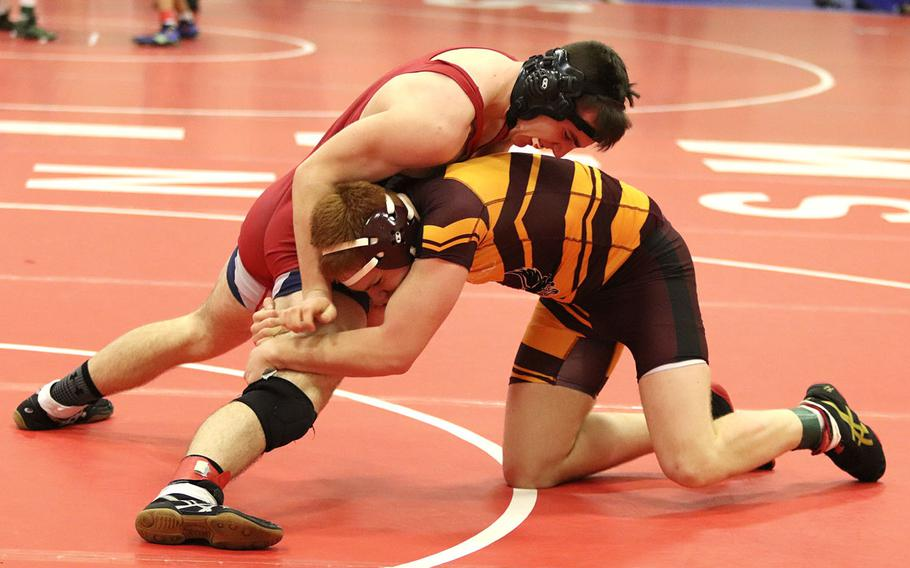 Nick Smith of the Aviano Saints tries to free his leg from Vilseck's Bradley Farris' hold during a wrestling tournament held at Aviano, Saturday, Jan. 18. Smith won the match 18-9.