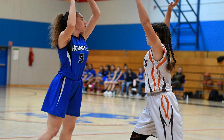 Hohenfels Tiger Rebecca Dick prepares to shoot the ball during Saturday's girls varsity basketball game, between the Hohenfels Tigers and the Spangdahlem Sentinels, held at Hohenfels. The Sentinels beat the Tigers 41-39.