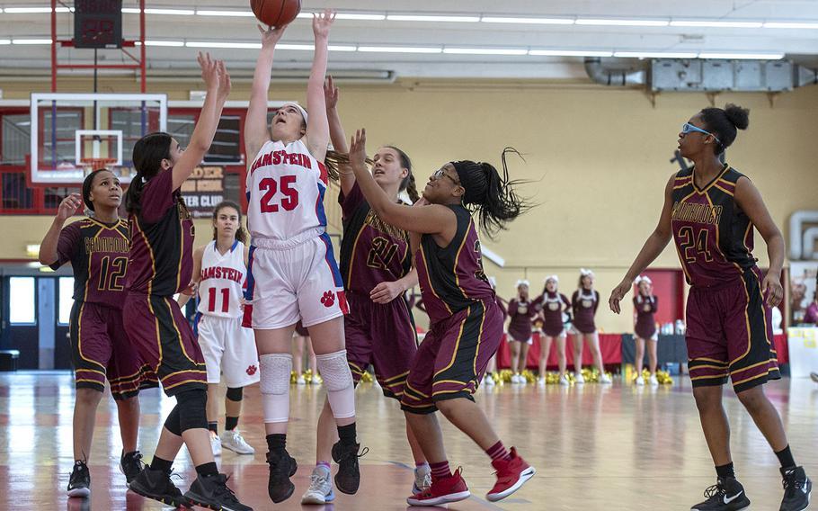 Ramstein's Linda Naglack takes a shot during Saturday's girls varsity basketball game against Baumholder, held at Baumholder. Ramstein won the game 42-9.