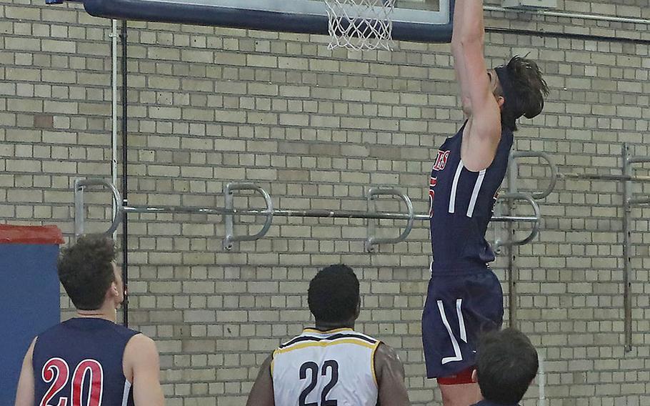 Lancer Marchall Dixon slams the ball in at the end of the Lakenheath-Stuttgart basketball game Saturday, Feb. 1, 2020 on RAF Lakenheath.