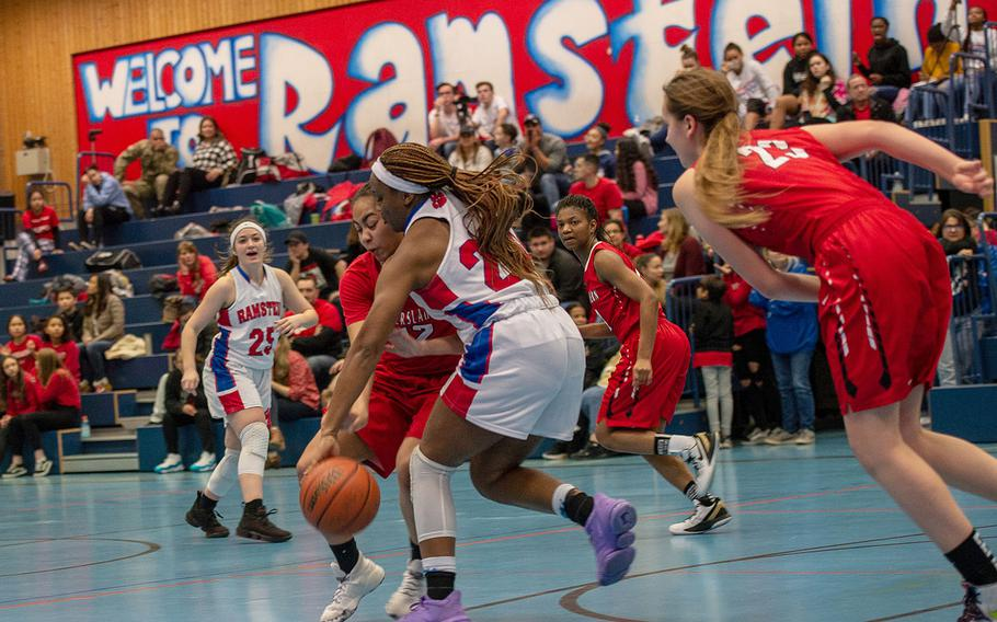 Kaiserslautern's Maya Henderson fouls Ramstein's Shannon McCray during the final seconds of a basketball game at Ramstein High School, Germany, Friday, Feb. 7, 2020. Ramstein won the game 34-30.