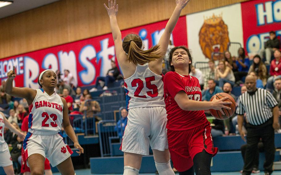 Kaiserslautern's Audrey Elisondo drives past a defender during a basketball game against Ramstein at Ramstein High School, Germany, Friday, Feb. 7, 2020. Ramstein won the game 34-30.