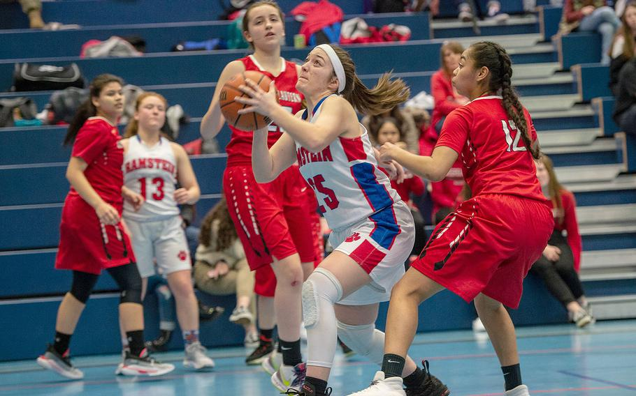 Ramstein's Linda Naglack takes a shot during a basketball game against Kaiserslautern at Ramstein High School, Germany, Friday, Feb. 7, 2020. Ramstein won the game 34-30.