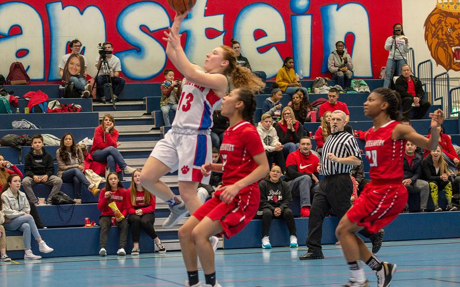 Ramstein's Alexis Tri goes in for a lay-up during a basketball game against Kaiserslautern at Ramstein High School, Germany, Friday, Feb. 7, 2020. Ramstein won the game 34-30.