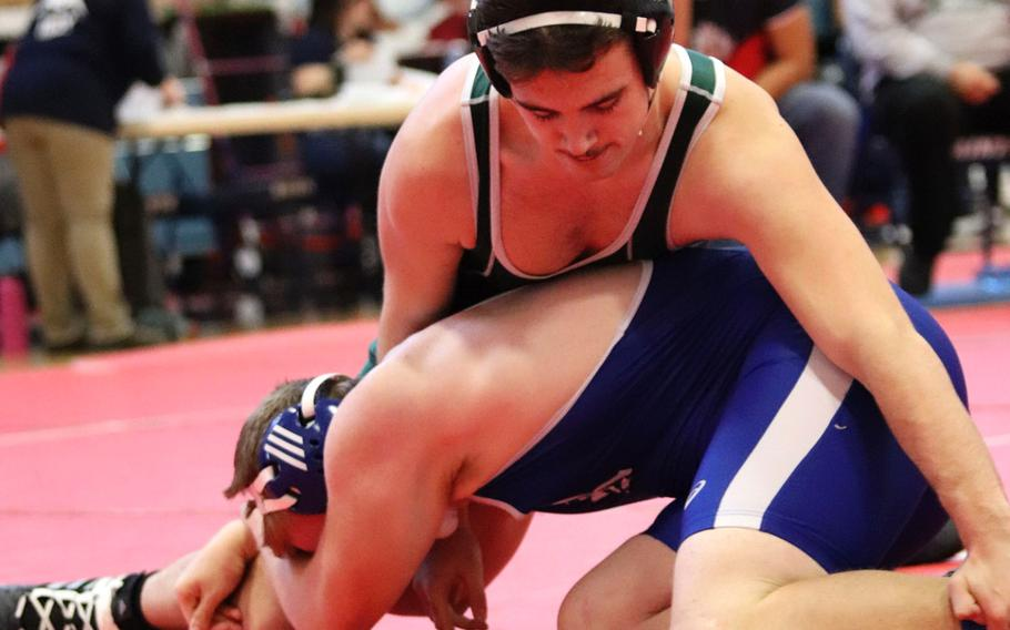 Naples' Kyle Burleson attemps to roll Rota's Jason Furner in the 182-pound weight class matchup of Saturday's wrestling sectional held at Aviano, Italy. Burleson won the match by pin and finished the day in fourth place at 182.