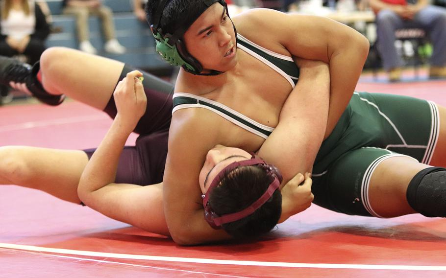 Naples' Nick Luminarias attempts to pin Vilseck's Thorin Bridges in the 195-pound weight class of Saturday's wrestling sectional held at Aviano, Italy. Luminarias was successful in pinning Bridges for the win. Luminarias also finished the day in first place at 195.