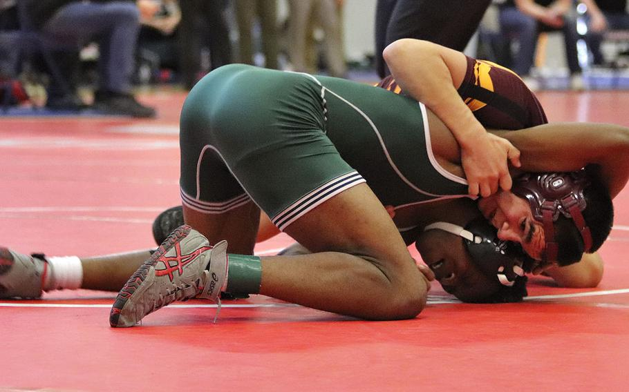 Vilseck's Caleb Debeltz tries to escape from Naples' Choosen Lakombe's grip in the 138-pound, first-place matchup of Saturday's wrestling sectional held at Aviano, Italy. In the end, Debelts was able to pin Lakombe for the win.