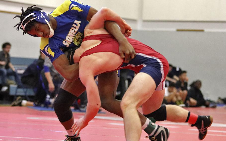 Sigonella's Amari Pyatt attempts to take down Aviano's Nick Smith in the first-place match at the 170-pound weight class of Saturday's Wrestling Sectionals held at Aviano, Italy. Pyatt pinned Smith for the win and that brings Pyatt's record to 19-0 going into the Euros.