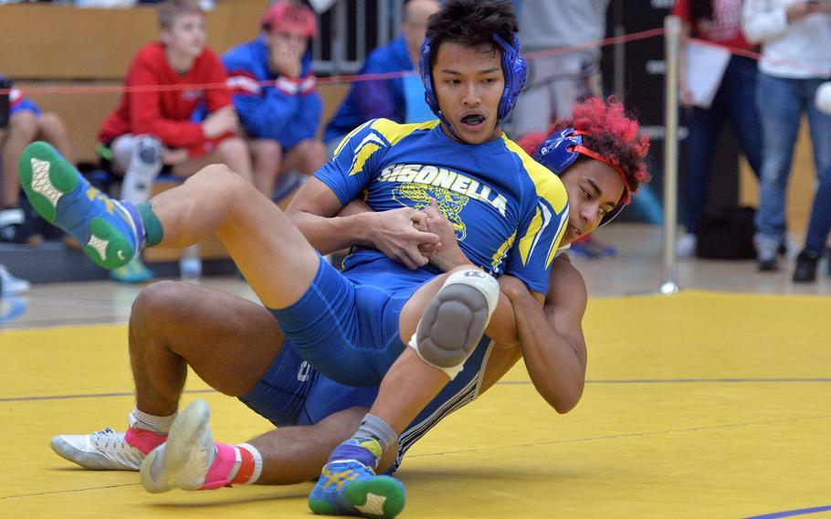 Ramstein's Brian McKinley pulls down Sigonella's Norman Nguyen in a 126-pound match at the DODEA-Europe wrestling championships in Wiesbaden that McKinley won.