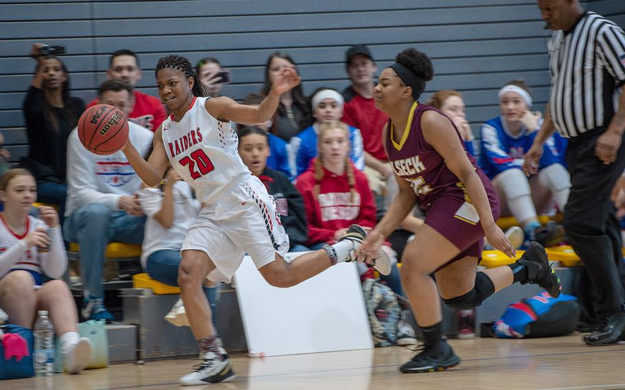 Kaiserslautern's Azora Williams tries to keep the ball inbounds after a steal during a game against Vilseck during the DODEA-Europe 2020 Division I basketball playoffs at the Southside gym on Ramstein Air Base, Germany, Thursday, Feb. 20, 2020.