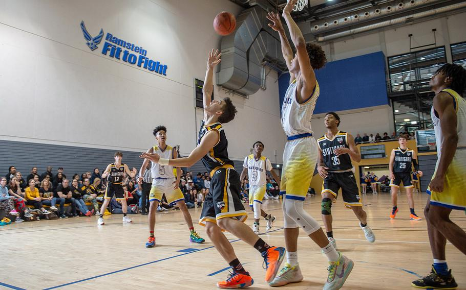 Stuttgart's Tyler Farrar takes an over the shoulder shot after driving the baseline during a game against Wiesbaden during the DODEA-Europe 2020 Division I basketball playoffs at the Southside gym on Ramstein Air Base, Germany, Thursday, Feb. 20, 2020.