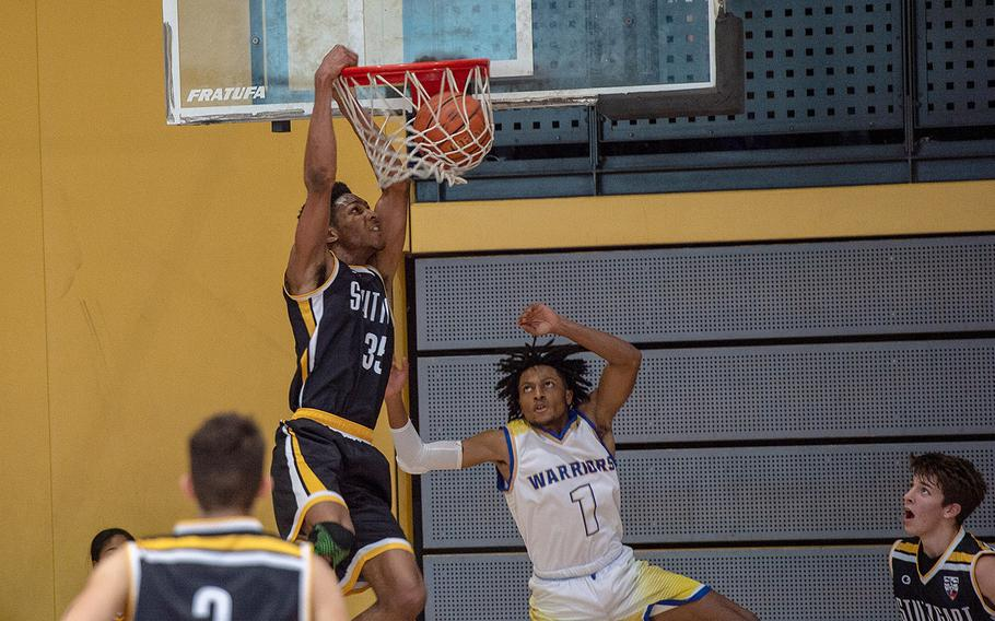 Stuttgart's Sabriel Ashley dunks during a game against Wiesbaden during the DODEA-Europe 2020 Division I basketball playoffs at the Southside gym on Ramstein Air Base, Germany, Thursday, Feb. 20, 2020.