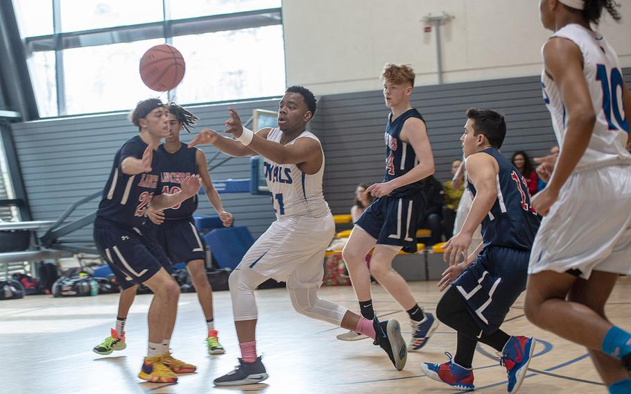 Ramstein's Carl Norman make a quick pass during a fast break during a game against Lakenheath during the DODEA-Europe 2020 Division I basketball playoffs at the Southside gym on Ramstein Air Base, Germany, Wednesday, Feb. 20, 2020.