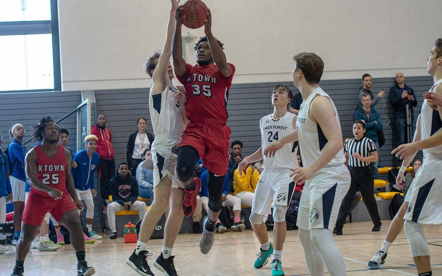 Kaiserslautern's Tre Dotson drives to the basket and makes the winning shot to beat Black Forest Academy 61-60 during the DODEA-Europe 2020 Division I basketball playoffs at the Southside gym on Ramstein Air Base, Germany, Thursday, Feb. 20, 2020.