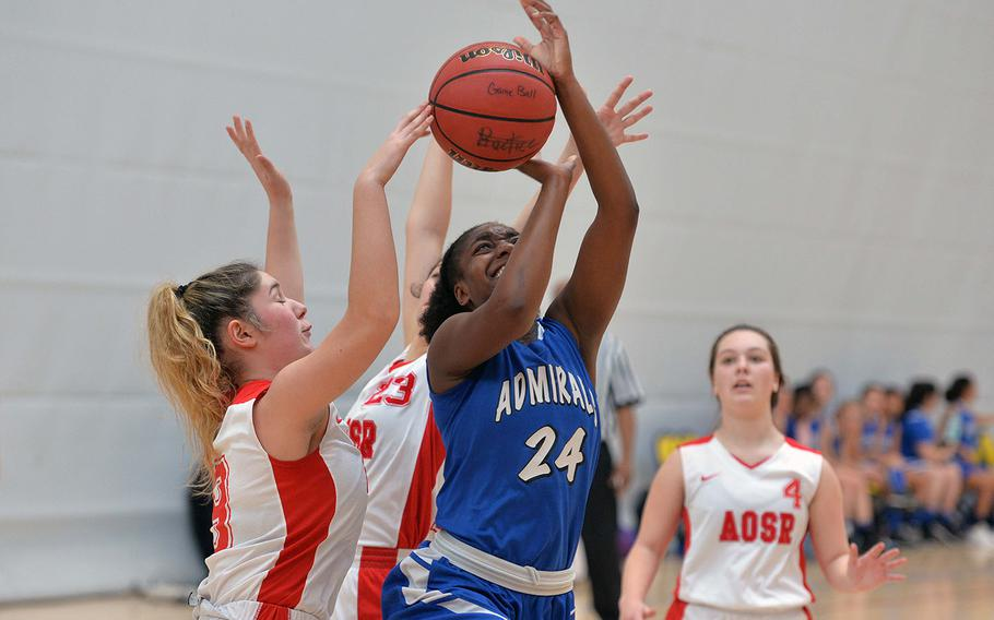 Rota's Brianna Leiba is fouled as she attempts a shot against AOSR's Claudia Ricci, left, and Maria Rossi in a Division II game at the DODEA-Europe basketball championships in Wiesbaden, Germany, Thursday, Feb. 20, 2020. AOSR won 28-11. Isabella Walsh watches the action at right.
