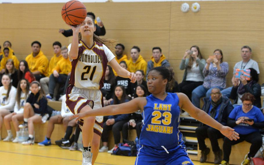 Lydia Coyour of Baumholder shoots over Sigonella's Jalissa Leejay in a Division III game at the DODEA-Europe basketball championships in Wiesbaden, Germany, Thursday, Feb. 20, 2020. The Jaguars won 27-26.