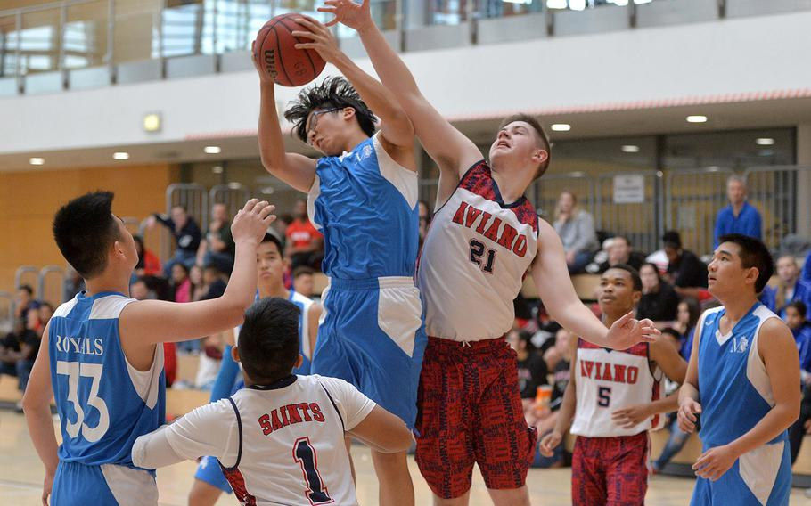 Marymount's Kevin Li pulls down a rebound against Aviano's Braden Lehde in a Division II game at the DODEA-Europe basketball championships in Wiesbaden, Germany, Thursday, Feb. 20, 2020. Aviano beat MMI 41-17.