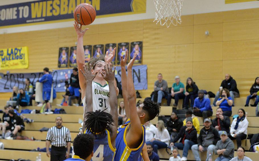 Alconbury's Liam Prendergast shoots over the Sigonella defense in a Division III game at the DODEA-Europe basketball championships in Wiesbaden, Germany, Thursday, Feb. 20, 2020. Alconbury won 57-36.