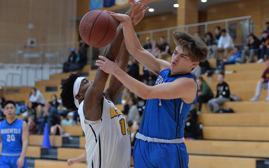 Caleb Love of Hohenfels passes to a teammate as Chandler Pigge of Baumholder defends in a Division III semifinal at the DODEA-Europe basketball championships in Wiesbaden, Germany, Friday, Feb. 21, 2020. Baumholder beat Hohenfels 73-58 to advance to the finals.