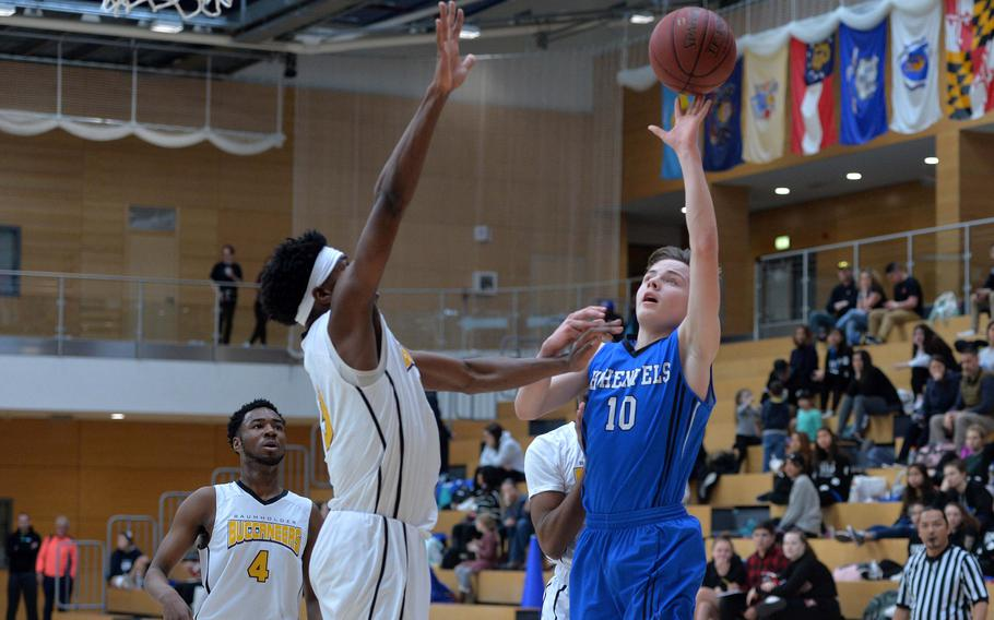 Deshawn Herold-Adams of Hohenfels shoots over Chandler Pigge of Baumholder in a Division III semifinal at the DODEA-Europe basketball championships in Wiesbaden, Germany, Friday, Feb. 21, 2020. Baumholder beat Hohenfels 73-58 to advance to the finals.