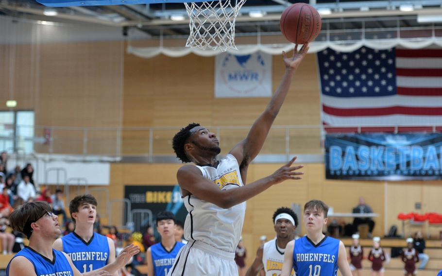 Laurence Huxtable of Baumholder gets past the Hohenfels defense for a layup in a Division III semifinal at the DODEA-Europe basketball championships in Wiesbaden, Germany, Friday, Feb. 21, 2020. Baumholder beat Hohenfels 73-58 to advance to the finals.
