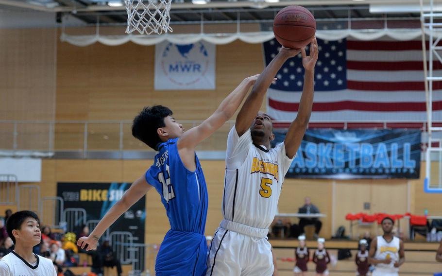 Robin Kim of Hohenfels defends against Derrick McCummings of Baumholder in a Division III semifinal at the DODEA-Europe basketball championships in Wiesbaden, Germany, Friday, Feb. 21, 2020. Baumholder beat Hohenfels 73-58 to advance to the finals.