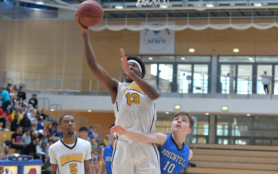 Chandler Pigge of Baumholder goes in for a basket against Deshawn Herold-Adams of Hohenfels in a Division III semifinal at the DODEA-Europe basketball championships in Wiesbaden, Germany, Friday, Feb. 21, 2020. Baumholder beat Hohenfels 73-58 to advance to the finals.