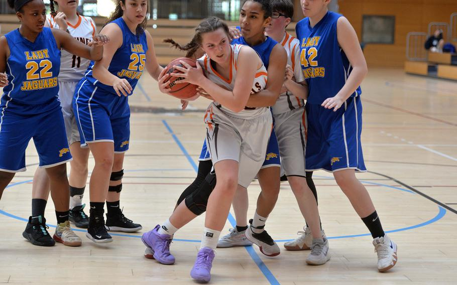 Emerson Retka of Spangdahlem wrestles the ball away from D'Anna Holland in a Division III semifinal at the DODEA-Europe basketball championships in Wiesbaden, Germany, Friday, Feb. 21, 2020. Spangdahlem won 39-14 to advance to the finals.