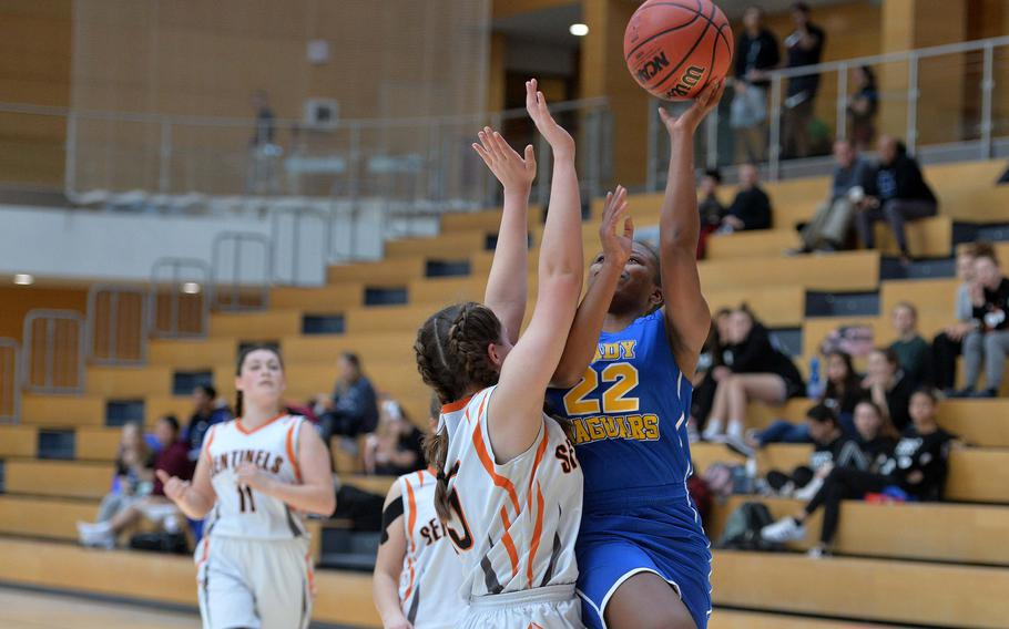 Sigonella's Shanyah Kentish shoots against Spangdahlem's Emerson Retka in a Division III semifinal at the DODEA-Europe basketball championships in Wiesbaden, Germany, Friday, Feb. 21, 2020. Spangdahlem won 39-14 to advance to the finals.