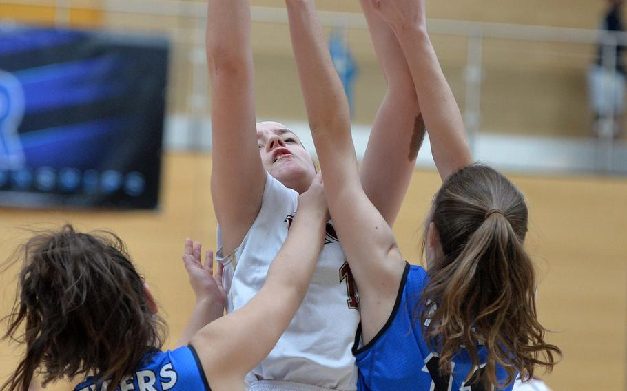 Trinity Ato of AFNORTH gets off a jumper over Rebecca Dick, left, and Allison Wenger in a Division III semifinal at the DODEA-Europe basketball championships in Wiesbaden, Germany, Friday, Feb. 21, 2020. Hohenfels won 36-31 to advance to the finals.