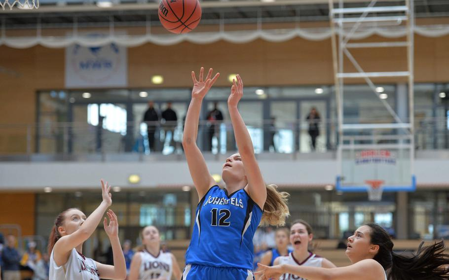 Tiana Rodgers takes a shot after getting past the AFNORTH defense in a Division III semifinal at the DODEA-Europe basketball championships in Wiesbaden, Germany, Friday, Feb. 21, 2020. Hohenfels won 36-31 to advance to the finals.