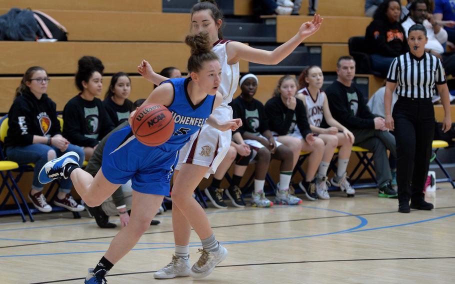 Karlie Perez of Hohenfels drives past Paula Bohlen of AFNORTH in a Division III semifinal at the DODEA-Europe basketball championships in Wiesbaden, Germany, Friday, Feb. 21, 2020. Hohenfels beat AFNORTH 36-31 to advance to the finals.