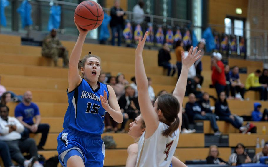 June Smith of Hohenfels shoots over Johanne Sandal of AFNORTH in a Division III semifinal at the DODEA-Europe basketball championships in Wiesbaden, Germany, Friday, Feb. 21, 2020. Hohenfels won 36-31 to advance to the finals.